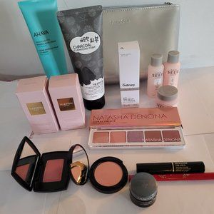 Makeup and skin care lot in silver bag